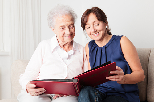 Older woman reading with adult daughter